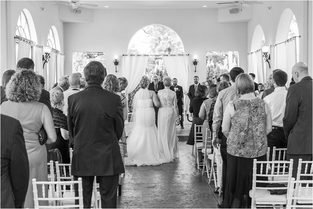 joyful-and-candid-navy-blush-wedding-photos-at-crystal-gardens-in-howell-mi-by-courtney-carolyn-photography_0032.jpg