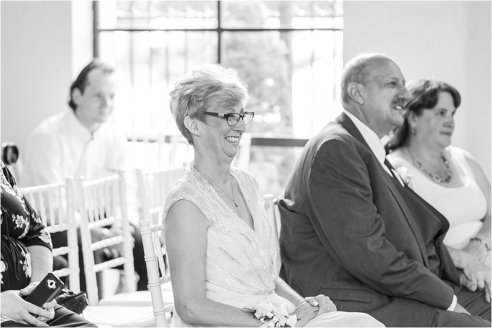 joyful-and-candid-navy-blush-wedding-photos-at-crystal-gardens-in-howell-mi-by-courtney-carolyn-photography_0039.jpg