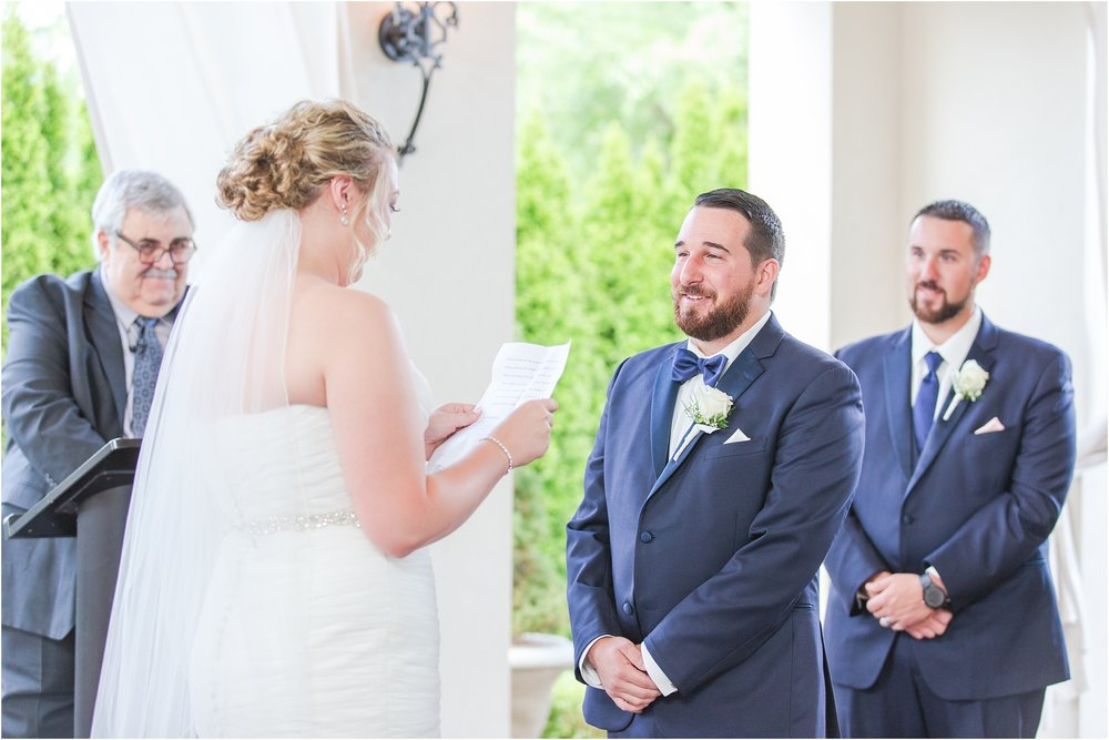 joyful-and-candid-navy-blush-wedding-photos-at-crystal-gardens-in-howell-mi-by-courtney-carolyn-photography_0043.jpg