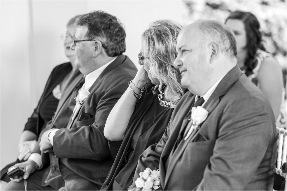 joyful-and-candid-navy-blush-wedding-photos-at-crystal-gardens-in-howell-mi-by-courtney-carolyn-photography_0045.jpg