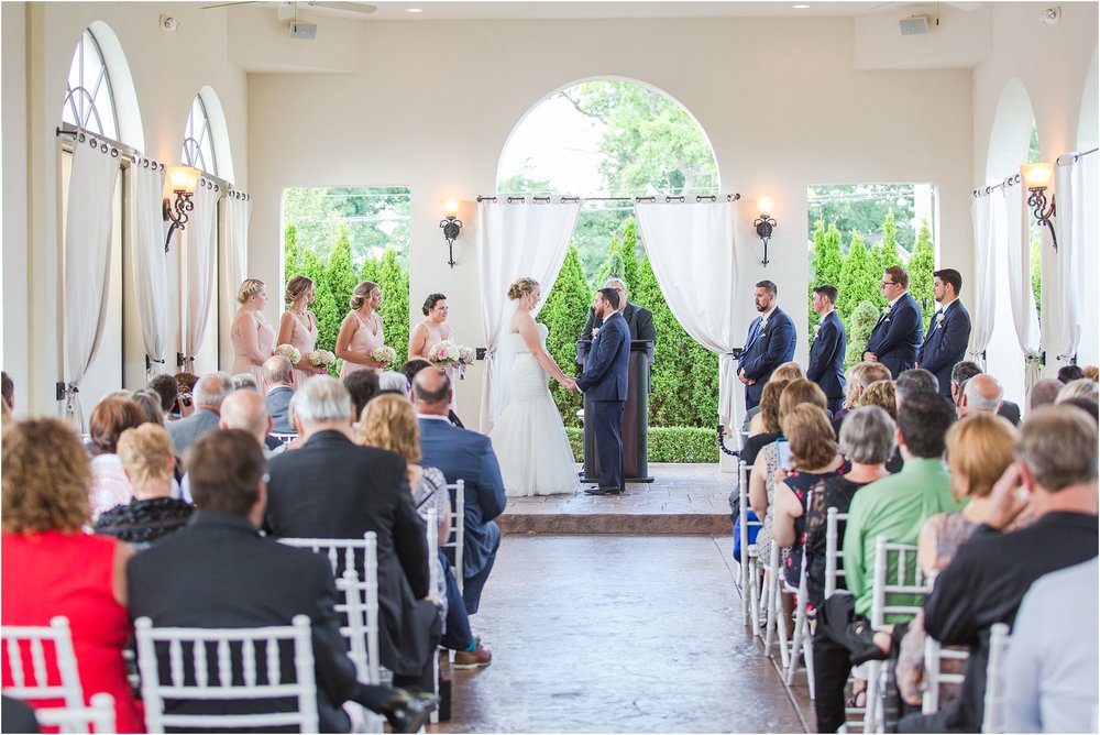 joyful-and-candid-navy-blush-wedding-photos-at-crystal-gardens-in-howell-mi-by-courtney-carolyn-photography_0047.jpg
