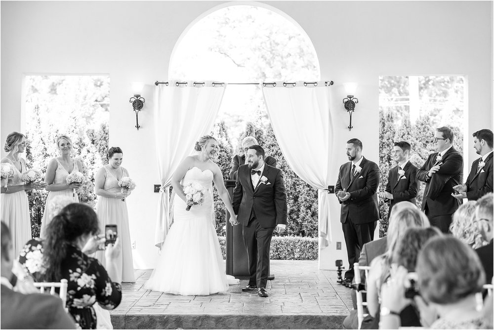 joyful-and-candid-navy-blush-wedding-photos-at-crystal-gardens-in-howell-mi-by-courtney-carolyn-photography_0056.jpg