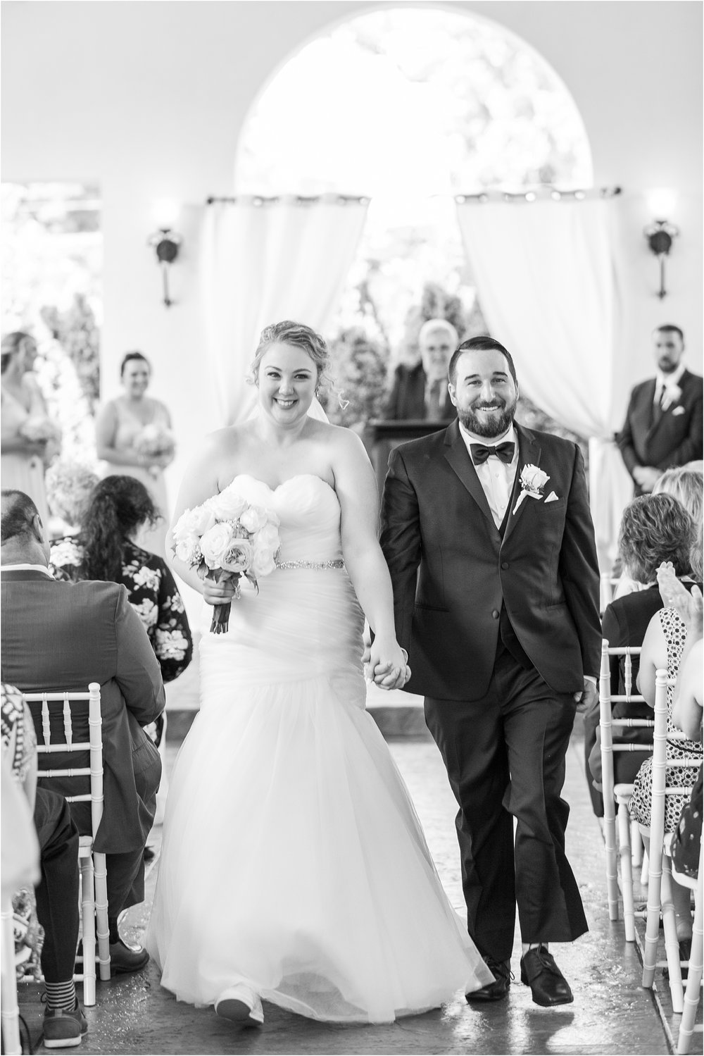 joyful-and-candid-navy-blush-wedding-photos-at-crystal-gardens-in-howell-mi-by-courtney-carolyn-photography_0057.jpg