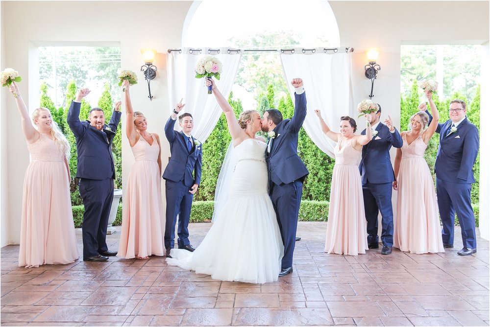 joyful-and-candid-navy-blush-wedding-photos-at-crystal-gardens-in-howell-mi-by-courtney-carolyn-photography_0059.jpg