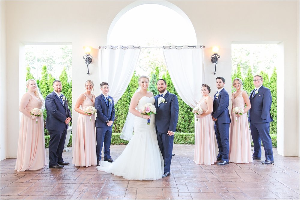 joyful-and-candid-navy-blush-wedding-photos-at-crystal-gardens-in-howell-mi-by-courtney-carolyn-photography_0066.jpg