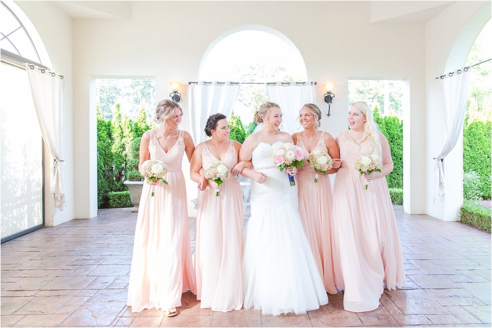 joyful-and-candid-navy-blush-wedding-photos-at-crystal-gardens-in-howell-mi-by-courtney-carolyn-photography_0071.jpg