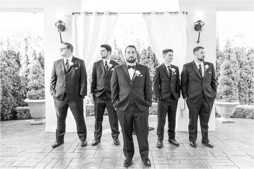 joyful-and-candid-navy-blush-wedding-photos-at-crystal-gardens-in-howell-mi-by-courtney-carolyn-photography_0072.jpg