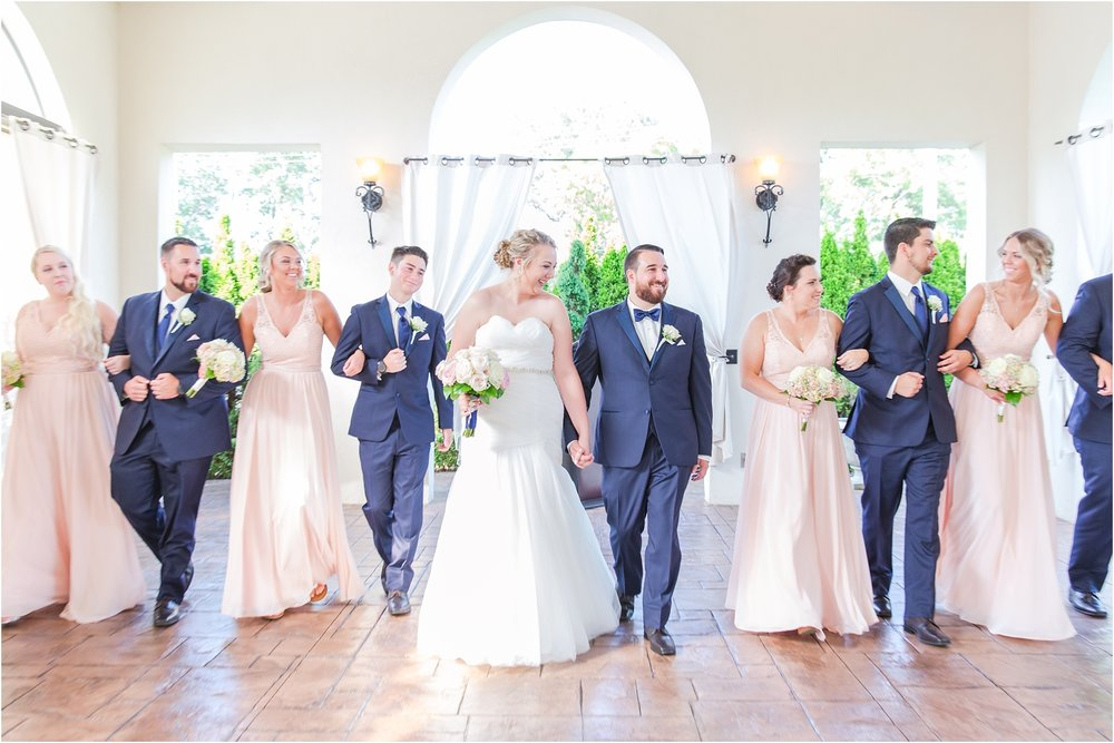 joyful-and-candid-navy-blush-wedding-photos-at-crystal-gardens-in-howell-mi-by-courtney-carolyn-photography_0074.jpg