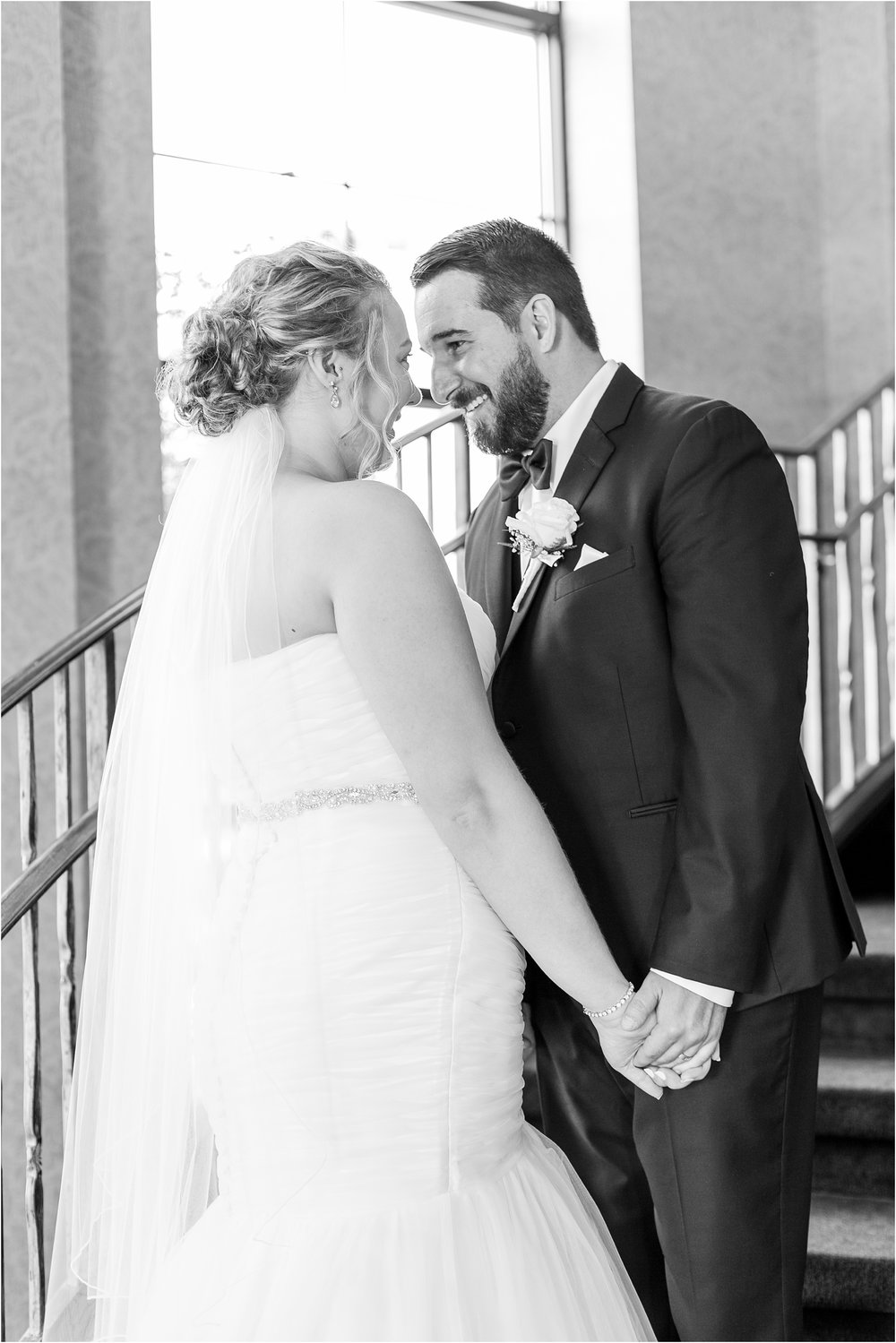 joyful-and-candid-navy-blush-wedding-photos-at-crystal-gardens-in-howell-mi-by-courtney-carolyn-photography_0075.jpg