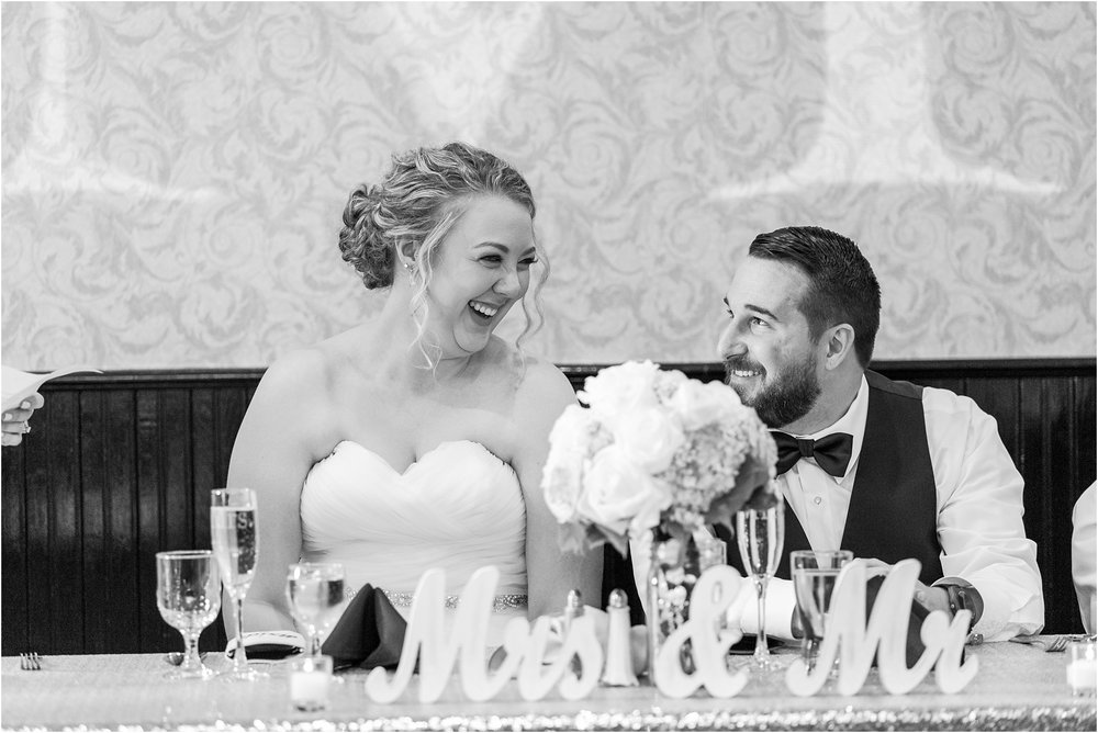 joyful-and-candid-navy-blush-wedding-photos-at-crystal-gardens-in-howell-mi-by-courtney-carolyn-photography_0078.jpg