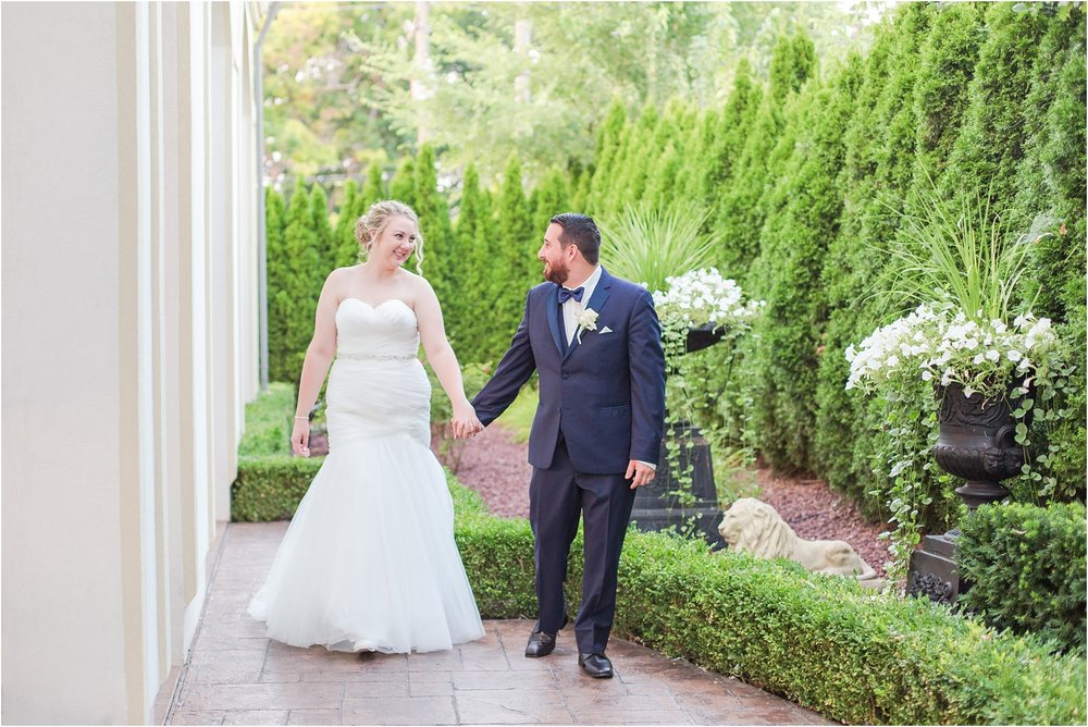 joyful-and-candid-navy-blush-wedding-photos-at-crystal-gardens-in-howell-mi-by-courtney-carolyn-photography_0093.jpg