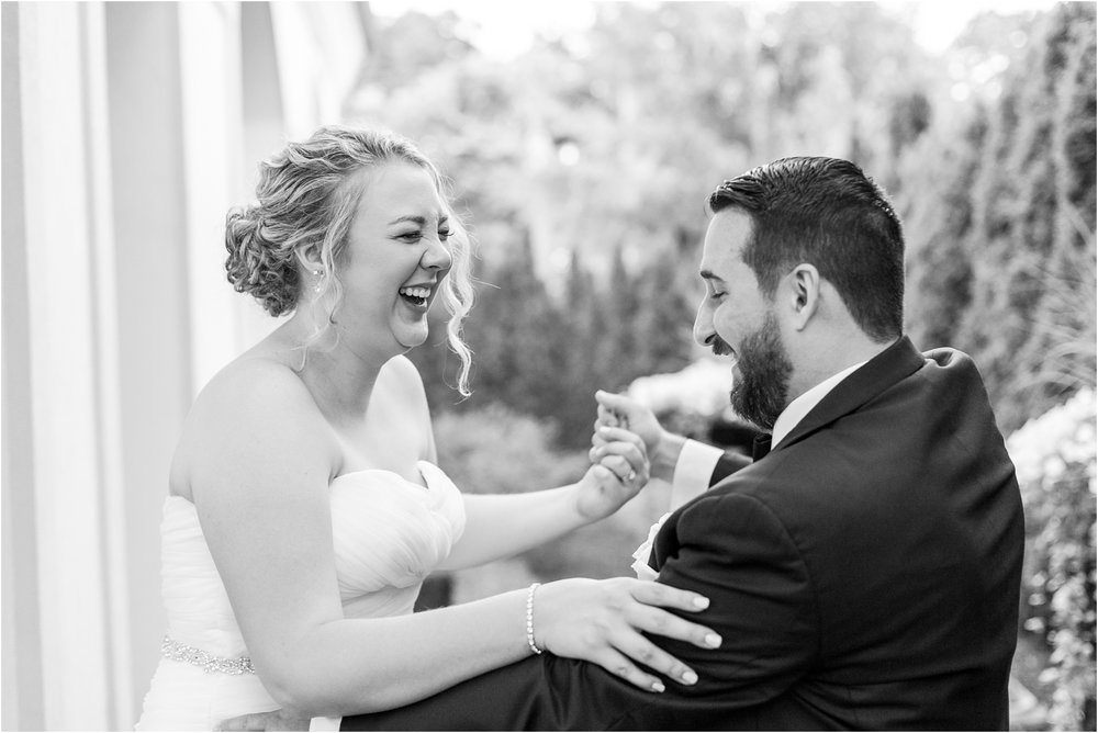 joyful-and-candid-navy-blush-wedding-photos-at-crystal-gardens-in-howell-mi-by-courtney-carolyn-photography_0095.jpg