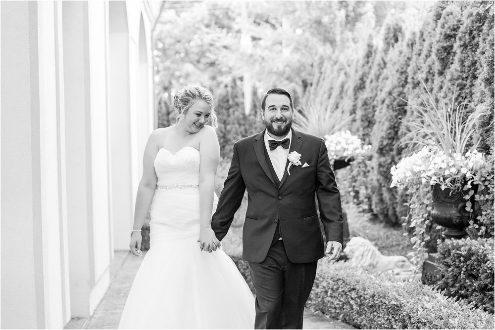 joyful-and-candid-navy-blush-wedding-photos-at-crystal-gardens-in-howell-mi-by-courtney-carolyn-photography_0098.jpg
