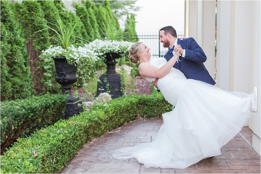 joyful-and-candid-navy-blush-wedding-photos-at-crystal-gardens-in-howell-mi-by-courtney-carolyn-photography_0100.jpg