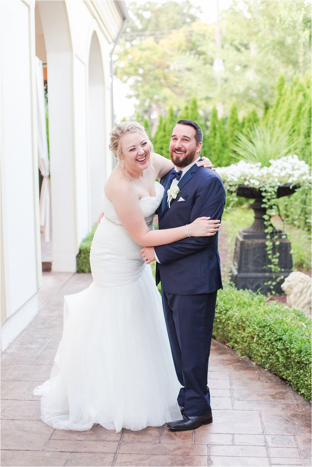 joyful-and-candid-navy-blush-wedding-photos-at-crystal-gardens-in-howell-mi-by-courtney-carolyn-photography_0099.jpg