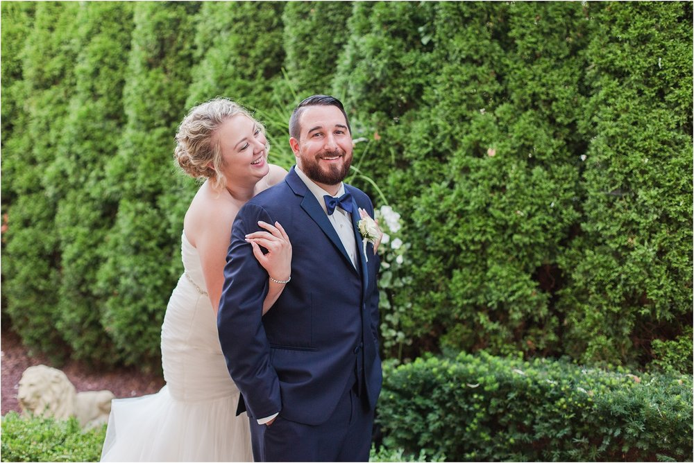joyful-and-candid-navy-blush-wedding-photos-at-crystal-gardens-in-howell-mi-by-courtney-carolyn-photography_0102.jpg