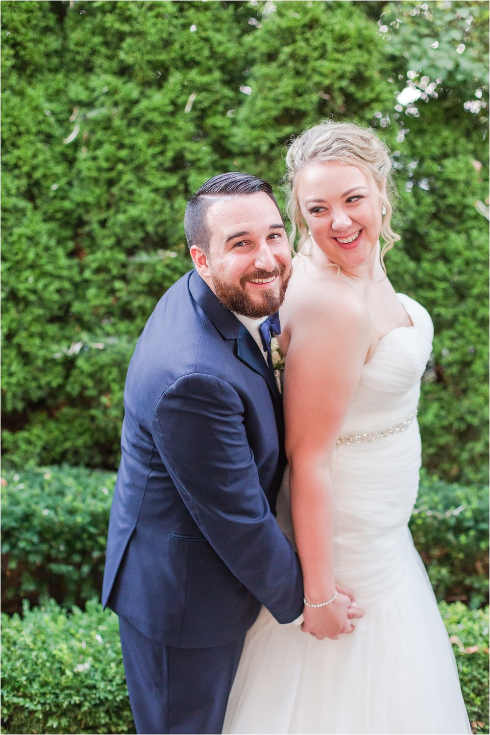 joyful-and-candid-navy-blush-wedding-photos-at-crystal-gardens-in-howell-mi-by-courtney-carolyn-photography_0105.jpg