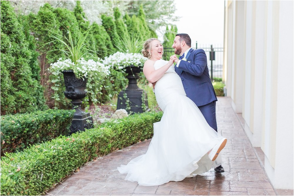 joyful-and-candid-navy-blush-wedding-photos-at-crystal-gardens-in-howell-mi-by-courtney-carolyn-photography_0108.jpg