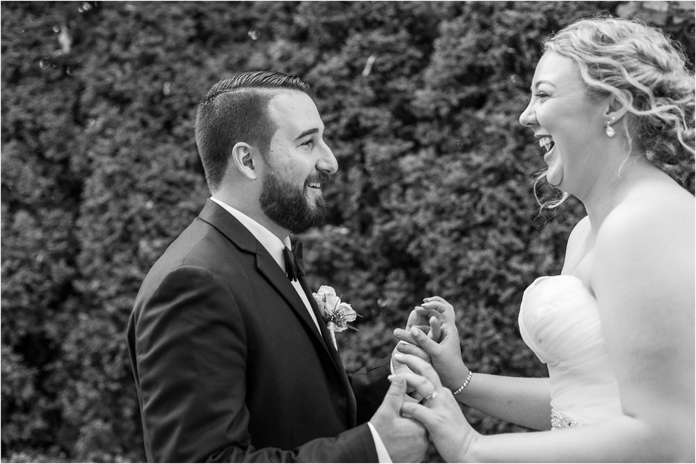 joyful-and-candid-navy-blush-wedding-photos-at-crystal-gardens-in-howell-mi-by-courtney-carolyn-photography_0111.jpg