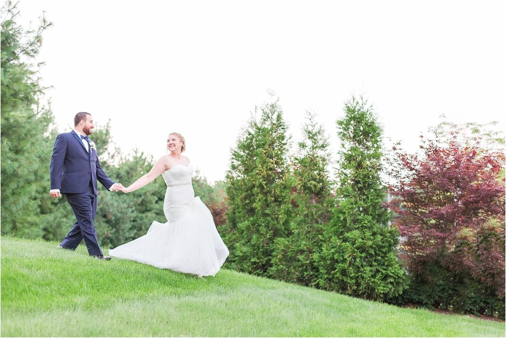 joyful-and-candid-navy-blush-wedding-photos-at-crystal-gardens-in-howell-mi-by-courtney-carolyn-photography_0113.jpg