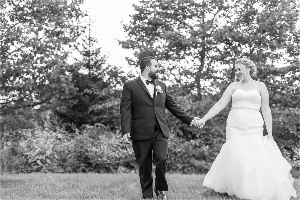 joyful-and-candid-navy-blush-wedding-photos-at-crystal-gardens-in-howell-mi-by-courtney-carolyn-photography_0114.jpg