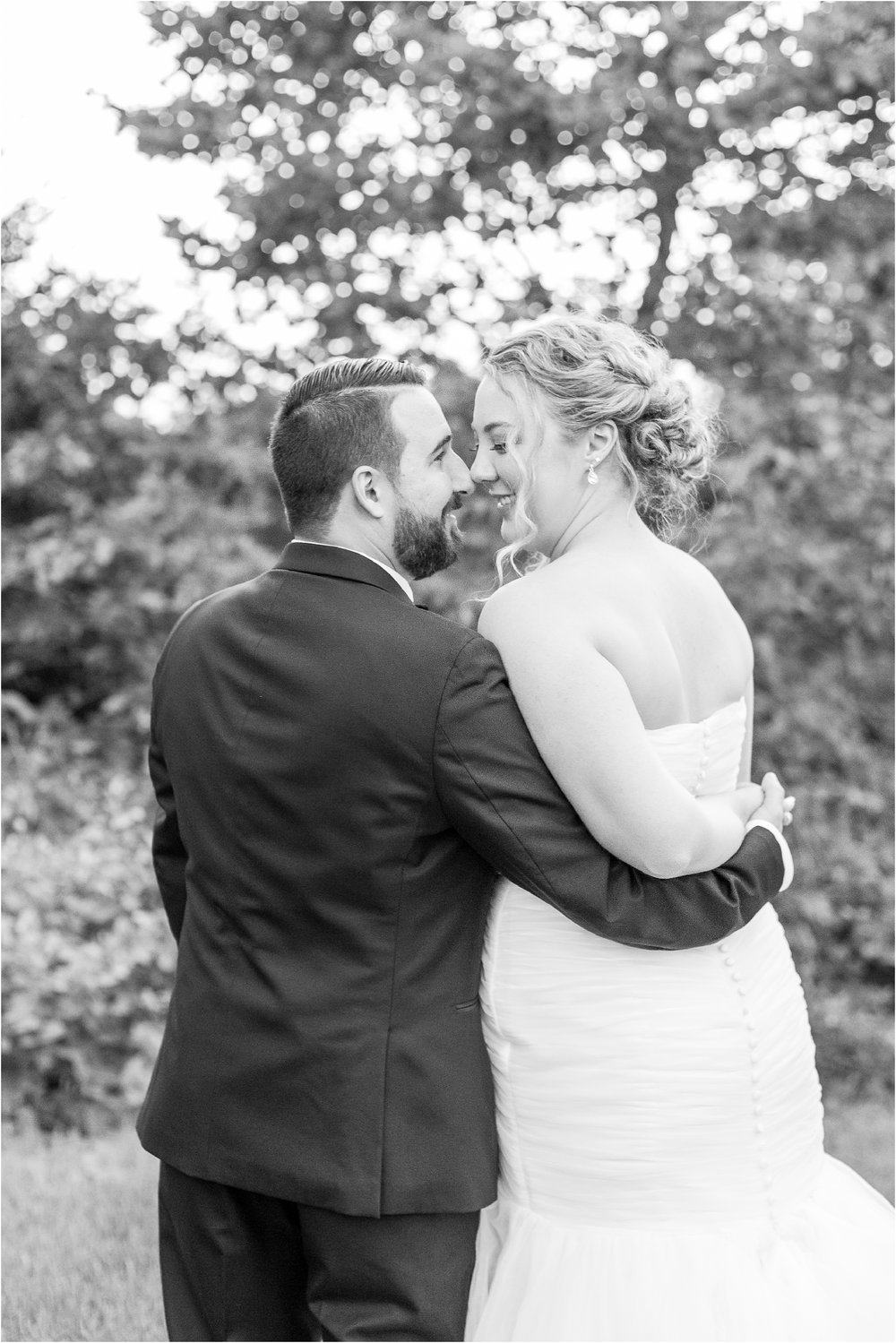 joyful-and-candid-navy-blush-wedding-photos-at-crystal-gardens-in-howell-mi-by-courtney-carolyn-photography_0116.jpg