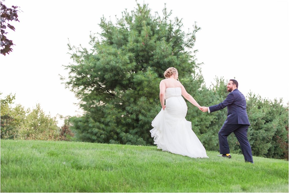 joyful-and-candid-navy-blush-wedding-photos-at-crystal-gardens-in-howell-mi-by-courtney-carolyn-photography_0119.jpg