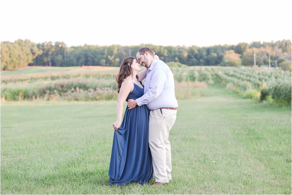 candid-romantic-summer-engagement-photos-at-hidden-lake-gardens-and-black-fire-winery-in-tipton-mi-by-courtney-carolyn-photography_0001.jpg