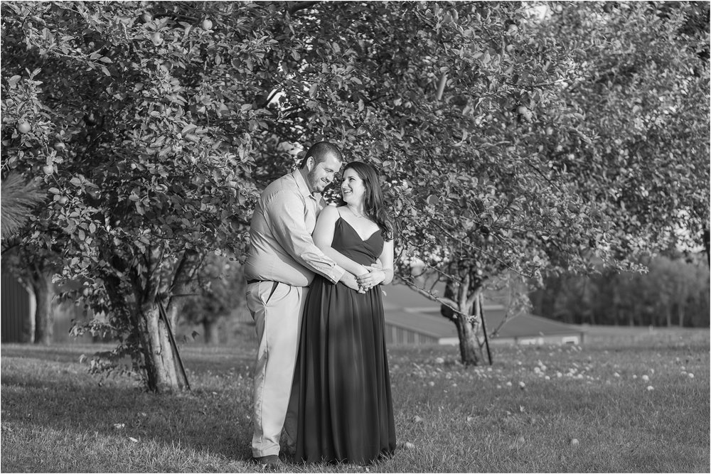 candid-romantic-summer-engagement-photos-at-hidden-lake-gardens-and-black-fire-winery-in-tipton-mi-by-courtney-carolyn-photography_0008.jpg