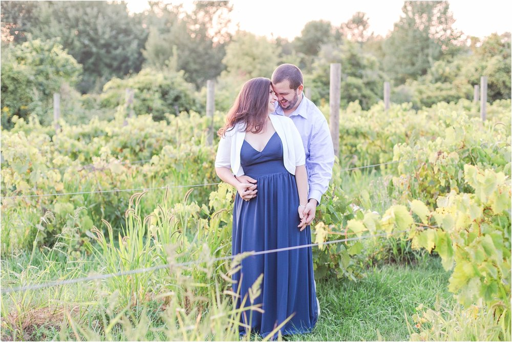 candid-romantic-summer-engagement-photos-at-hidden-lake-gardens-and-black-fire-winery-in-tipton-mi-by-courtney-carolyn-photography_0015.jpg