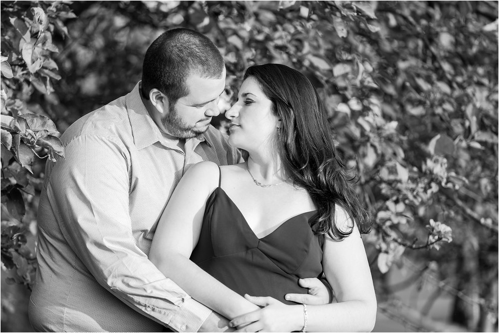 candid-romantic-summer-engagement-photos-at-hidden-lake-gardens-and-black-fire-winery-in-tipton-mi-by-courtney-carolyn-photography_0017.jpg