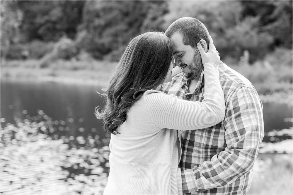 candid-romantic-summer-engagement-photos-at-hidden-lake-gardens-and-black-fire-winery-in-tipton-mi-by-courtney-carolyn-photography_0025.jpg