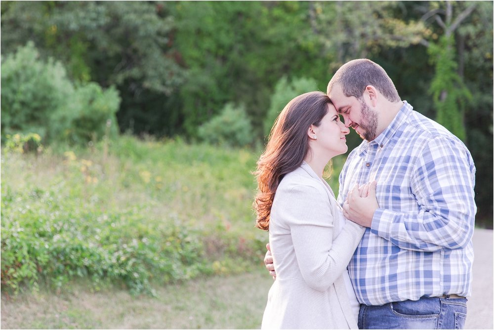 candid-romantic-summer-engagement-photos-at-hidden-lake-gardens-and-black-fire-winery-in-tipton-mi-by-courtney-carolyn-photography_0031.jpg