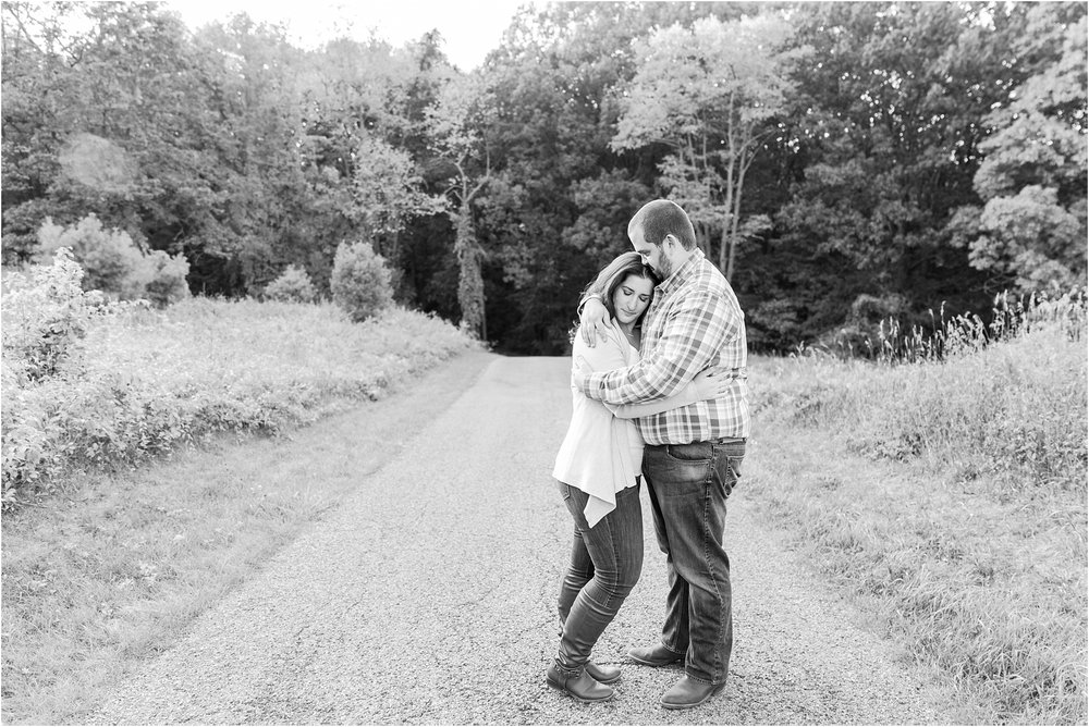 candid-romantic-summer-engagement-photos-at-hidden-lake-gardens-and-black-fire-winery-in-tipton-mi-by-courtney-carolyn-photography_0039.jpg