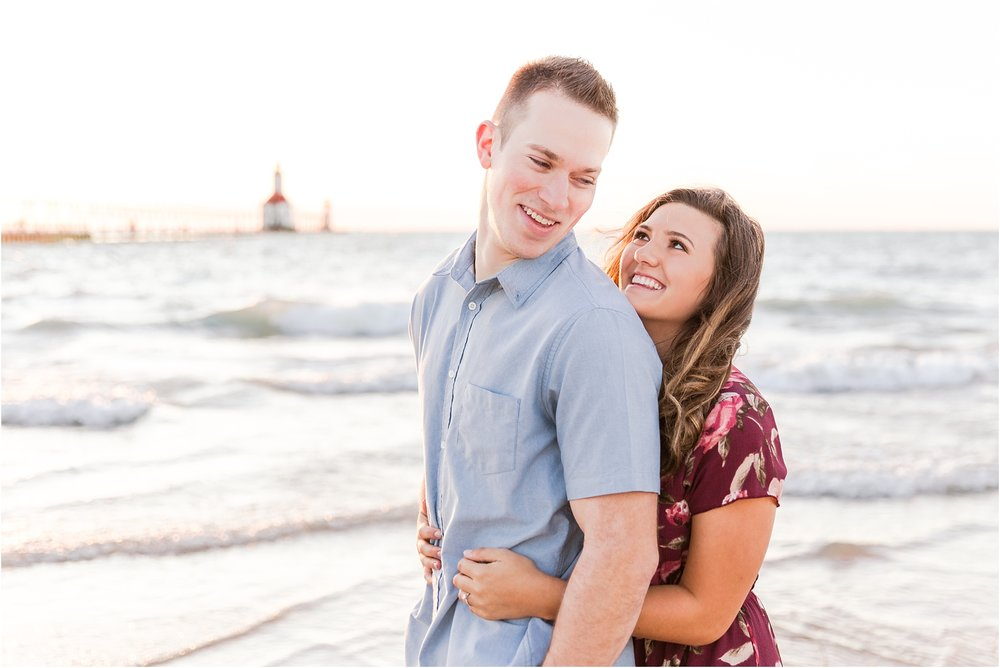 candid-end-of-summer-sunset-engagement-photos-at-silver-beach-in-st-joseph-mi-by-courtney-carolyn-photography_0001.jpg