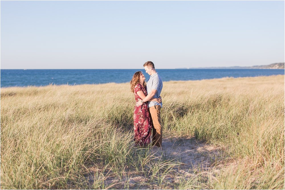candid-end-of-summer-sunset-engagement-photos-at-silver-beach-in-st-joseph-mi-by-courtney-carolyn-photography_0023.jpg