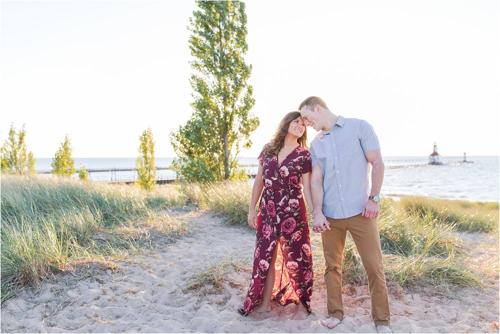 candid-end-of-summer-sunset-engagement-photos-at-silver-beach-in-st-joseph-mi-by-courtney-carolyn-photography_0029.jpg