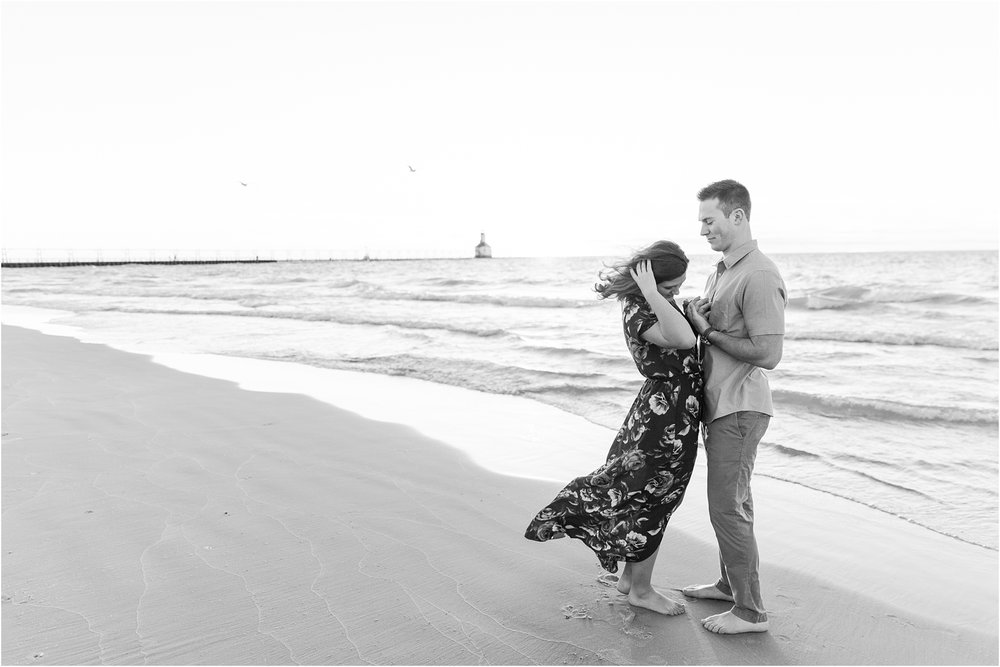 candid-end-of-summer-sunset-engagement-photos-at-silver-beach-in-st-joseph-mi-by-courtney-carolyn-photography_0034.jpg