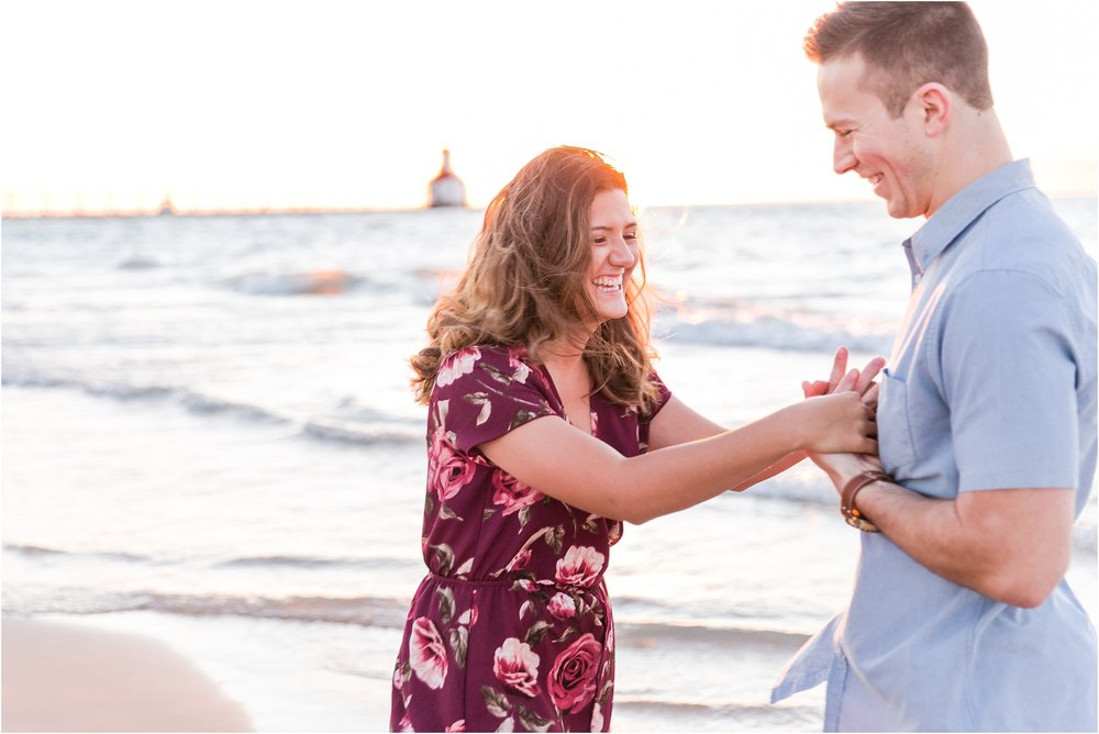 candid-end-of-summer-sunset-engagement-photos-at-silver-beach-in-st-joseph-mi-by-courtney-carolyn-photography_0037.jpg