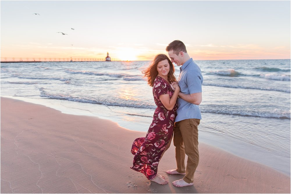 candid-end-of-summer-sunset-engagement-photos-at-silver-beach-in-st-joseph-mi-by-courtney-carolyn-photography_0039.jpg