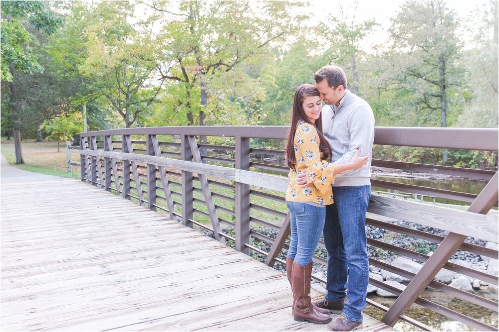 relaxed-autumn-engagement-photos-at-hudson-mills-metropark-in-dexter-mi-by-courtney-carolyn-photography_0038.jpg