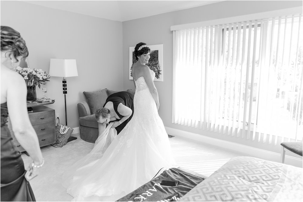 classic-natuical-inspired-wedding-photos-on-infinity-ovation-yacht-in-st-clair-shores-mi-by-courtney-carolyn-photography_0006.jpg