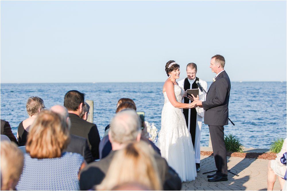 classic-natuical-inspired-wedding-photos-on-infinity-ovation-yacht-in-st-clair-shores-mi-by-courtney-carolyn-photography_0047.jpg