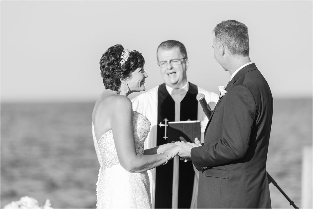 classic-natuical-inspired-wedding-photos-on-infinity-ovation-yacht-in-st-clair-shores-mi-by-courtney-carolyn-photography_0053.jpg