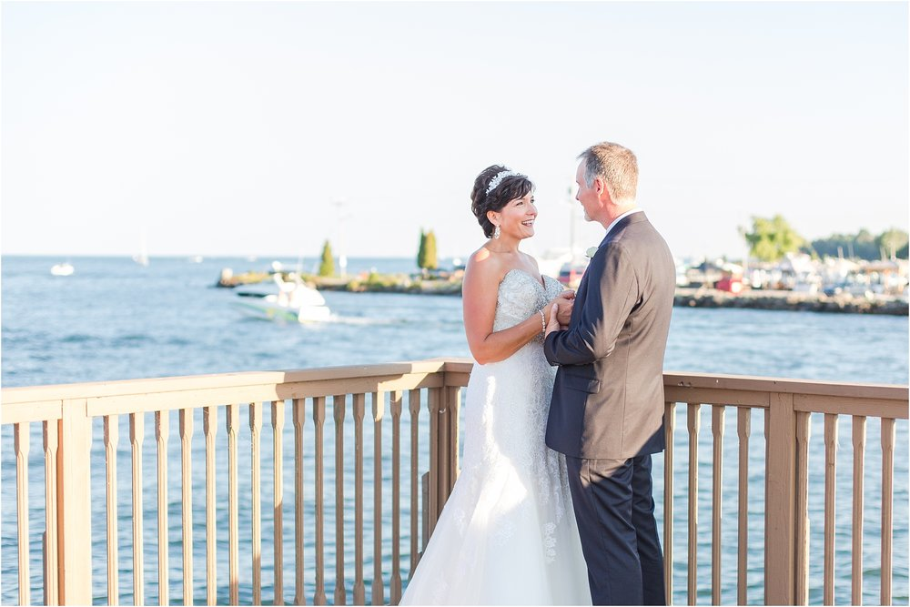 classic-natuical-inspired-wedding-photos-on-infinity-ovation-yacht-in-st-clair-shores-mi-by-courtney-carolyn-photography_0056.jpg