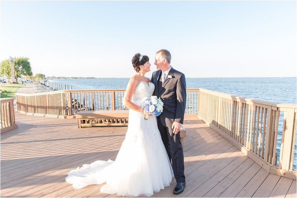 classic-natuical-inspired-wedding-photos-on-infinity-ovation-yacht-in-st-clair-shores-mi-by-courtney-carolyn-photography_0062.jpg