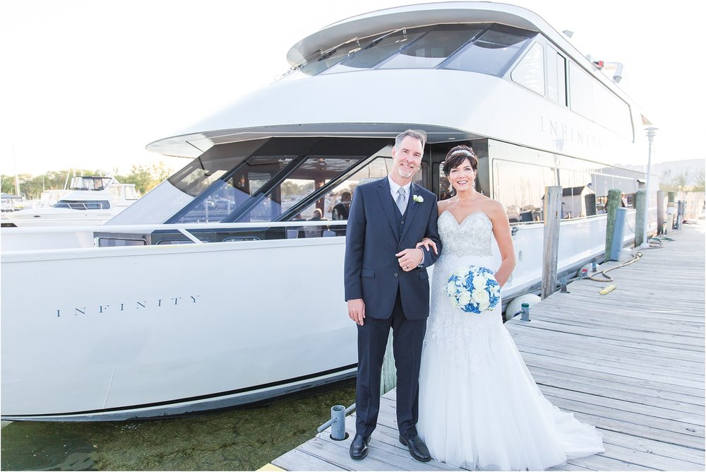 classic-natuical-inspired-wedding-photos-on-infinity-ovation-yacht-in-st-clair-shores-mi-by-courtney-carolyn-photography_0067.jpg