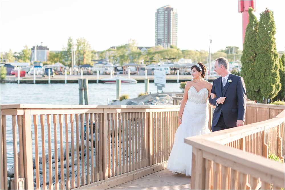 classic-natuical-inspired-wedding-photos-on-infinity-ovation-yacht-in-st-clair-shores-mi-by-courtney-carolyn-photography_0069.jpg