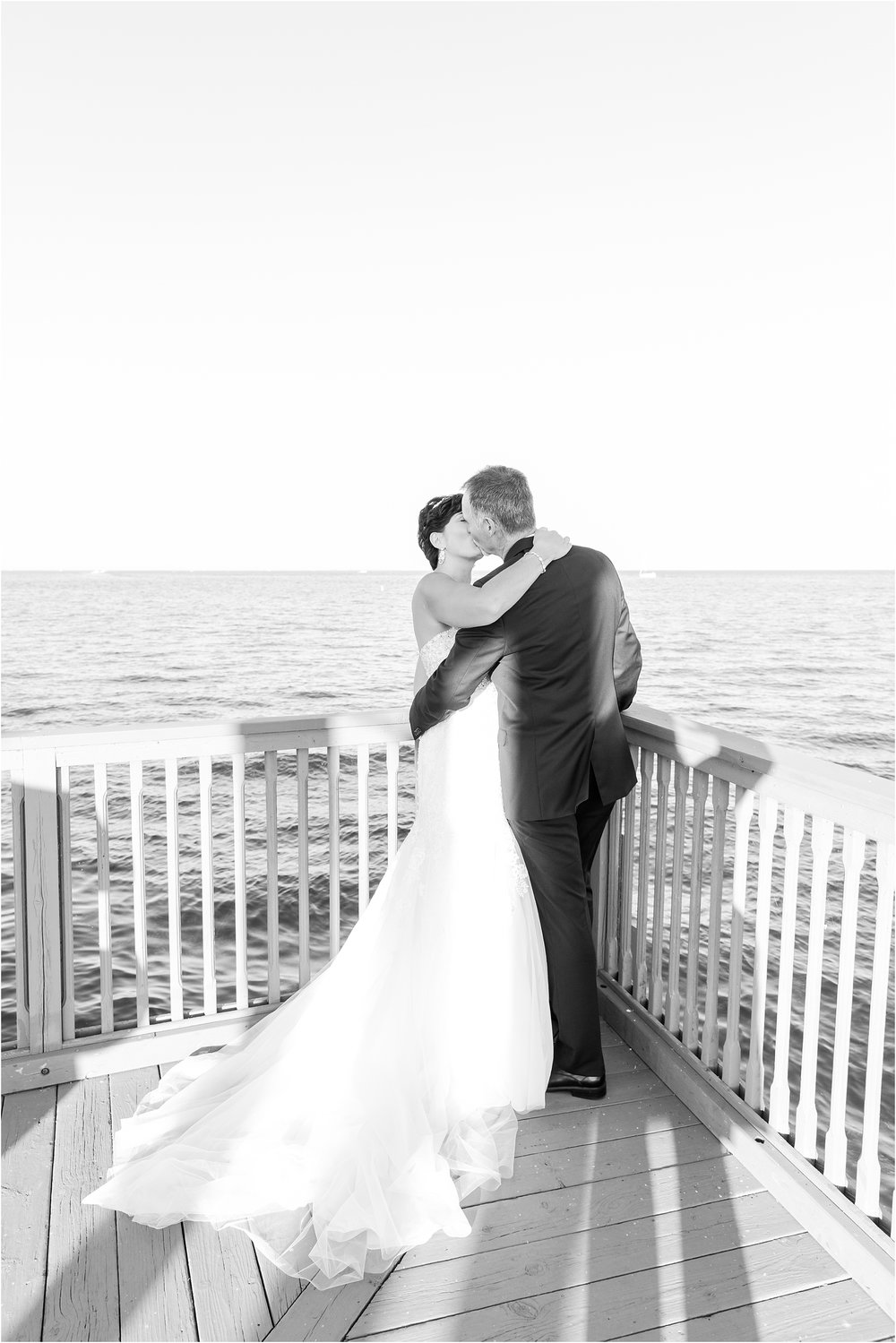 classic-natuical-inspired-wedding-photos-on-infinity-ovation-yacht-in-st-clair-shores-mi-by-courtney-carolyn-photography_0070.jpg