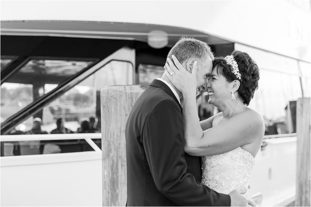 classic-natuical-inspired-wedding-photos-on-infinity-ovation-yacht-in-st-clair-shores-mi-by-courtney-carolyn-photography_0071.jpg